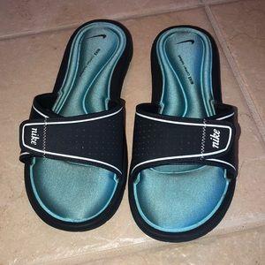 Nike comfort slides.